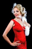 beautiful young blond woman wearing a red dress, retro style