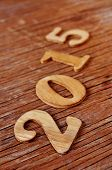 wooden numbers forming 2015, as the new year, on a rustic wooden surface