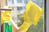 Cleaning windows with special rag and cleaner
