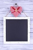Chalkboard on wooden background