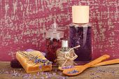 Spa still life with lavender oil and flowers on wooden table