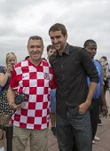 US Open 2014 champion Marin Cilic with Croatian tennis fan on the Top of the Rock Observation Deck