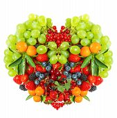 Heart Shaped Mix Of Fruits And Berries On White