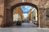 People On Street Via Del Mascherino In Rome. Gate In The Wall, Enclosing Vatican City. Rome, Italy