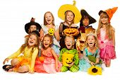 Many kids sit in group wearing Halloween costumes