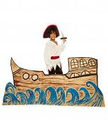 image of home theater  - Boy playing in home theater wearing pirate costume and sailing on cardboard ship holding dagger looking at camera and smiling - JPG
