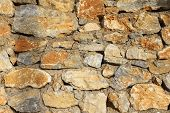 foto of old stone fence  - Fragment of old stone wall - JPG