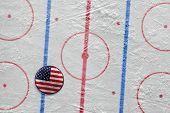 American puck lying on the hockey rink