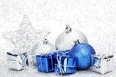 Christmas decoration on shiny silver glitter background