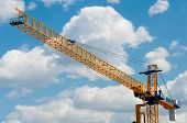 stock photo of boom-truck  - Construction crane against the sky in summer - JPG