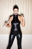 image of latex woman  - Sexy woman in latex catsuit bite whip bdsm - JPG