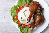 foto of roast duck  - roasted duck leg with rice and vegetables on closeup horizontal - JPG