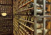 pile of vintage  wine bottles