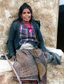 Nepal Woman Sitting Before Her Lodge