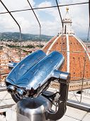Sightseeing binoculars pointing to the Dome of Basilica di Santa Maria del Fiore (Saint Mary of the Flower), Florence, Tuscany, Italy, Europe.
