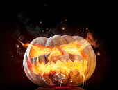 Halloween pumpkin with fire flames isolated on black background