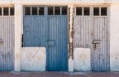 The Old Blue Doors Of The Deserted Room