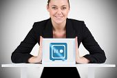 Businesswoman showing tablet pc against white background with vignette