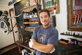 Portrait of smiling business owner in bicycle shop