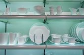 image of crockery  - White crockery on shelves in a shop - JPG