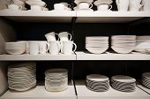 White Crockery On Shelves