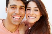 Portrait Of Happy Young Hispanic Couple