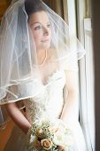 Beautiful Bride Wearing Wedding Dress Holding Bouquet