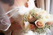 Close Up Of Bride Holding Bouquet