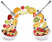 stock photo of fruit bowl  - Eating fruit salad in bowl with fruits like apples oranges kiwi grapes peach banana and strawberry - JPG