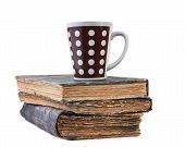 cup on books isolated on a white background