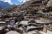 stock photo of mustang  - Rooftop view over Marpa village - JPG