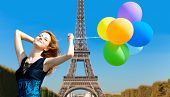 Redhead Girl With Colour Balloons On Parisian Eiffel Tower Background.
