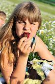 Girl Liking Strawberry