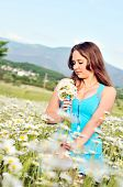 Girl With Bunch Of Daisies
