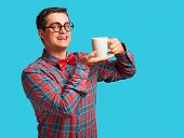 Nerd With Cup Of Coffee On Blue Background.