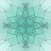 stock photo of stained glass  - soft blue wintry background with snowflake looking kaleidoscope - JPG