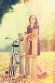 Beautiful Redhead Women With Bike In Versailles Gardens. France