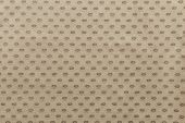 pic of oval  - texture of beige fabric with repeating spots ovals for abstract backgrounds and for wallpaper - JPG
