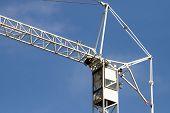 Crane On A Blue Sky Background