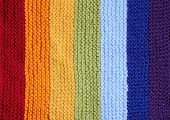 Knitted background in rainbow colors