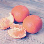 picture of clementine-orange  - Orange tangerines on a wooden background - JPG