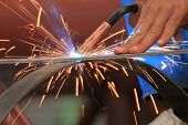 stock photo of welding  - welder is welding steel flat bar without safety glove