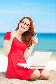 Redhead Girl In The Glasses With Notebook On The Beach