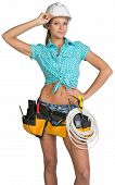 Woman in hard hat and tool belt posing