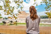 Young Woman On Embankment Looking On Castel Sant'angelo In Rome