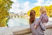 Happy Mother And Baby Girl Sightseeing On Bridge Ponte Umberto I