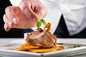 stock photo of restaurant  - Chef in hotel or restaurant kitchen cooking - JPG