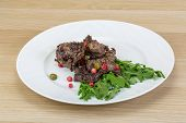 foto of deer meat  - Roasted venison meat with ruccola and cranberries - JPG