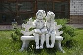 Statuette Of A Boy And A Girl On A Bench