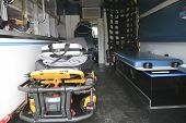 The Inside of a paramedic ambulance with stretcher on it.